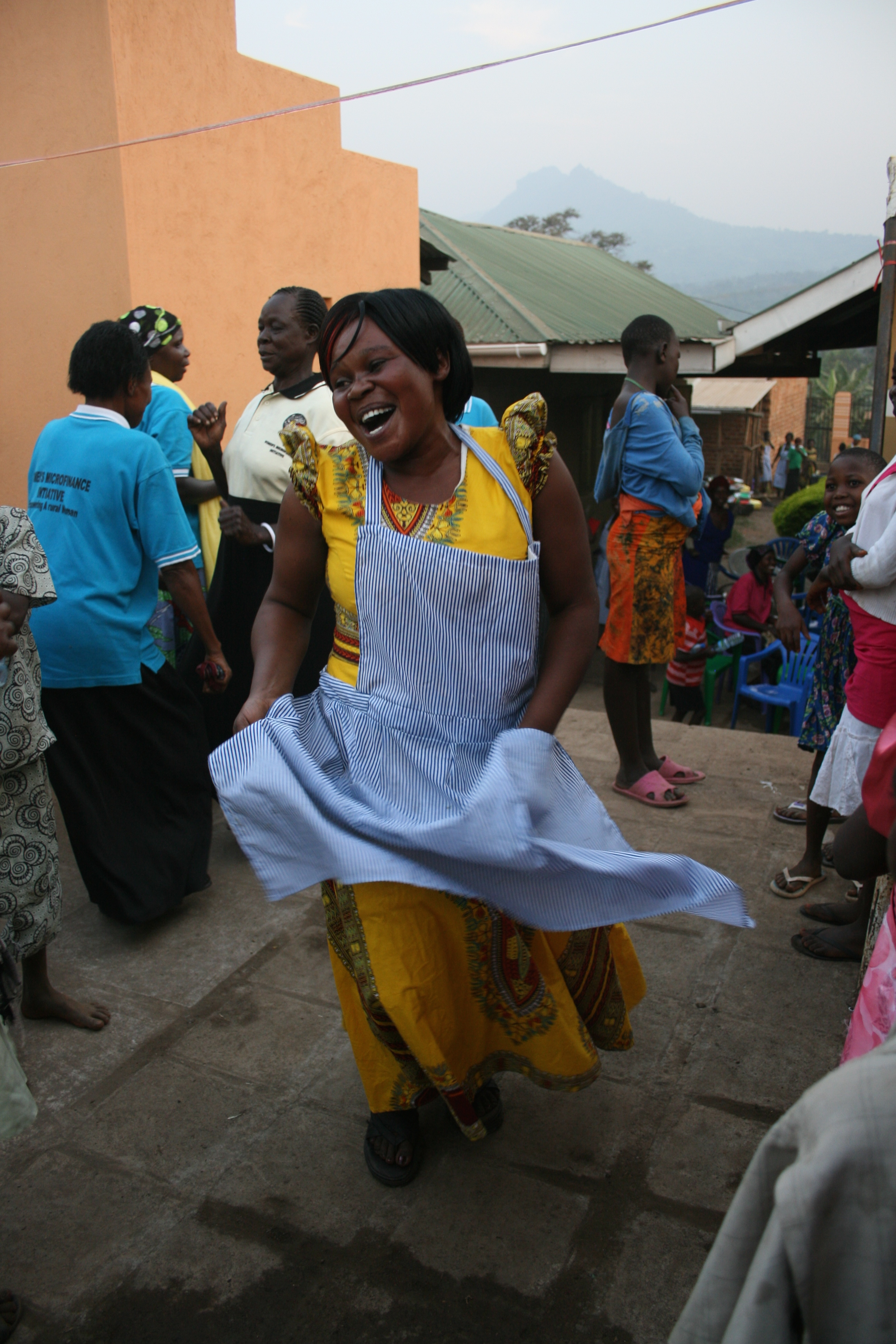 Woman dancing at WMI Uganda graduation