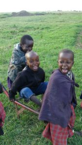 Sangau, Denis and Nashipai playing at boma--all are Tumaini students now