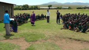 Greeting the school children in Alailelai